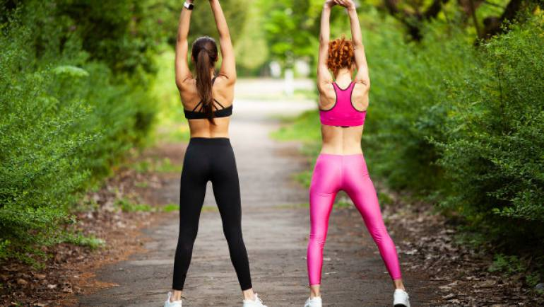 two-women-exercising-park-young-beautiful-woman-doing-exercises-together-outdoors_118454-848.jpg
