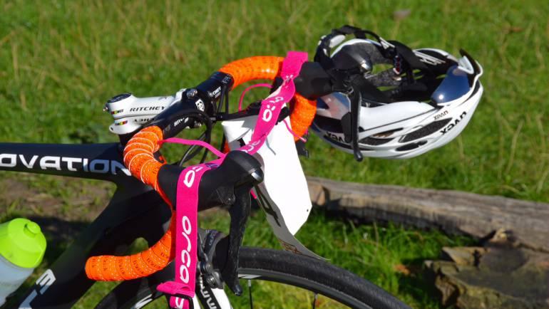 race-belt-on-bike-handlebars-in-triathlon-transition_55eea6a62c016.jpg